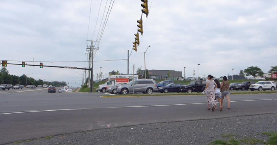 woman crossing road portfolio